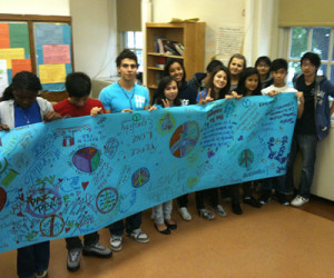 Newcomers High School students with banner in tribute to Marcelo Lucero.