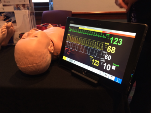 A mannequin at a simulation technology vendor booth. These high-fidelity simulators have pulses and injection sites, some can perspire and convulse.